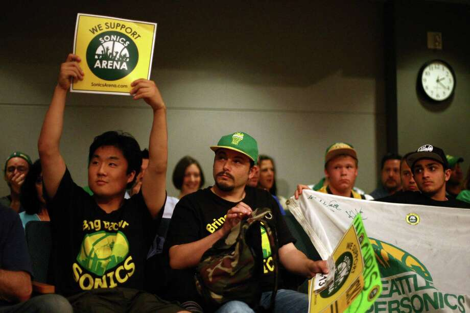From left, Joseph Chong, Jason Billingsley show their support for a speaker during a meeting of the King County Council on Monday, July 30, 2012 at Metropolitan King County Council chambers. Photo: JOSHUA TRUJILLO / SEATTLEPI.COM