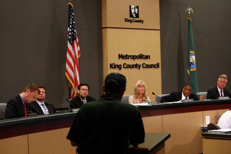 A speaker addresses members of the during a meeting of the King County Council as they prepare to vote on a proposal for a new NBA/NHL arena on Monday, July 30, 2012 at Metropolitan King County Council chambers. Photo: JOSHUA TRUJILLO / SEATTLEPI.COM