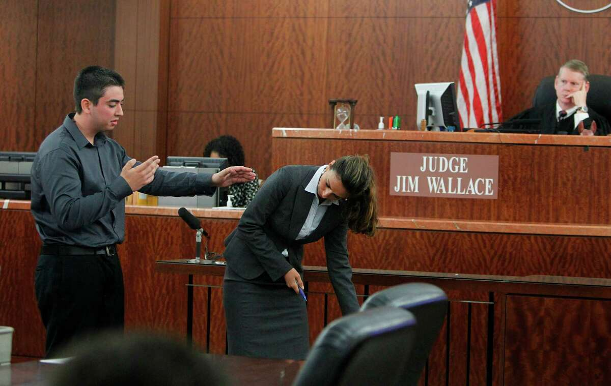 Witness Alan Perez and prosecutor Tina Ansari demonstrate a killing to jurors during a July 2012 murder trial in Houston.