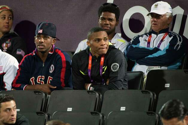 USA basketball players Chris Paul, left, and Russell Westbrook watch a beach volleyball game at the 2012 London Olympics on Monday, July 30, 2012. Photo: Smiley N. Pool, Houston Chronicle / © 2012  Houston Chronicle