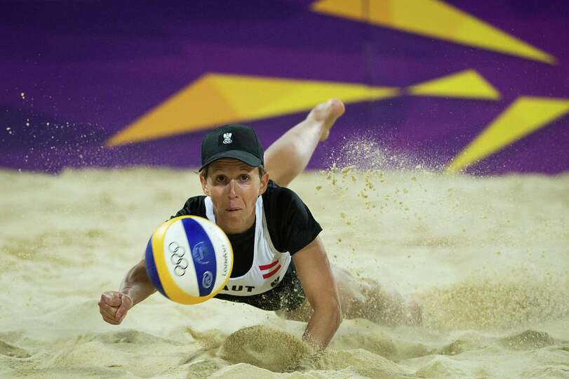 Doris Schwaiger of Austria dives for a ball during a beach volleyball at the 2012 London Olympics on