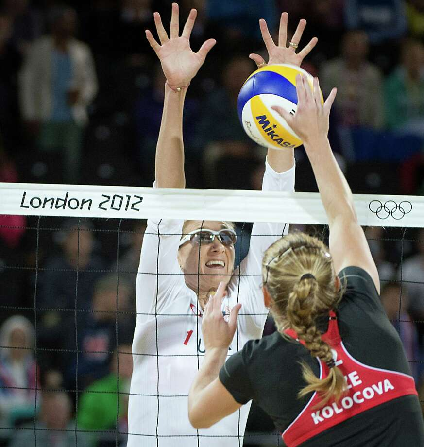 Kerri Walsh goes for a block during a beach volleyball match against Czech Republic at the 2012 London Olympics on Monday, July 30, 2012. Photo: Smiley N. Pool, Houston Chronicle / © 2012  Houston Chronicle