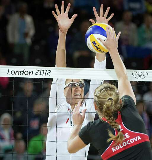 Kerri Walsh goes for a block during a beach volleyball match against Czech Republic at the 2012 Lond