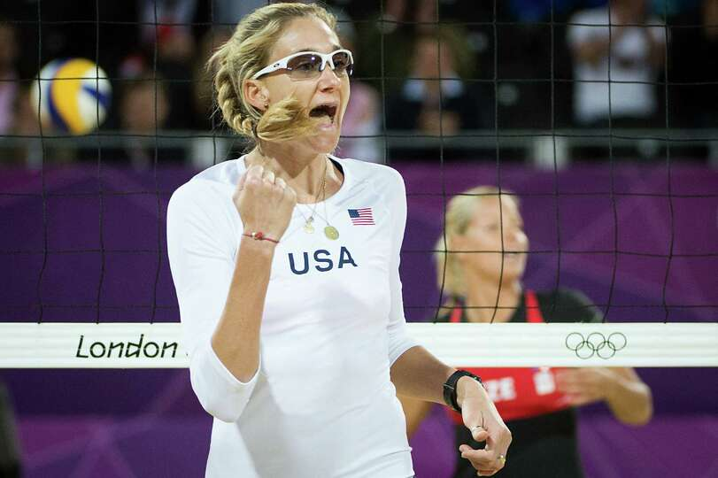 Kerri Walsh celebrates after scoring a point during a beach volleyball match against Czech Republic