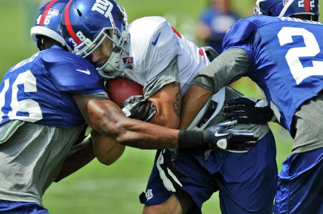 New York Giants running back Joe Martinek carries the ball during  a training camp practice at UAlbany on Monday July 30, 2012 in Albany, NY.  (Philip Kamrass / Times Union) Photo: Philip Kamrass / 00018618A