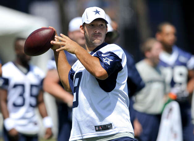 Dallas Cowboys quarterback Tony Romo passes the ball as he executes a play during NFL training camp, Monday, July 30, 2012, in Oxnard, Calif. Photo: Gus Ruelas,  Associated Press / FR157633 AP