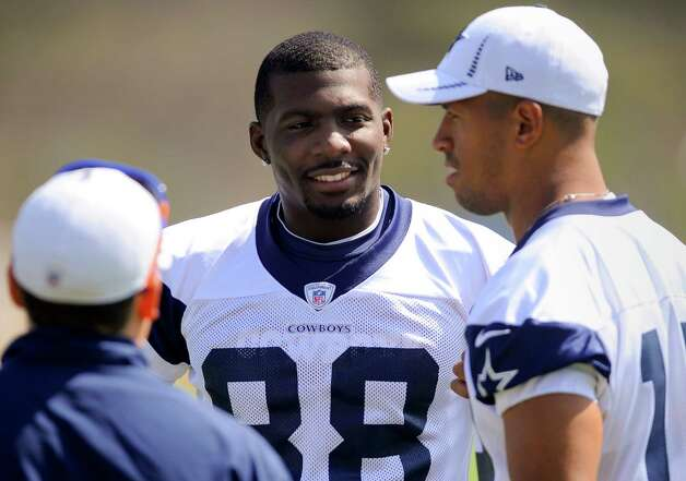 Dallas Cowboys wide receivers Dez Bryant (88) and Miles Austin, right, talk during NFL football training camp, Monday, July 30, 2012, in Oxnard, Calif. Photo: Gus Ruelas,  Associated Press / FR157633 AP