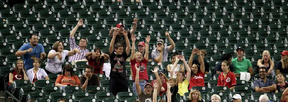The few fans coming out to support the Astros try to work up some enthusiasm by doing a wave at a game last week in Minute Maid Park. Photo: Karen Warren / © 2012  Houston Chronicle