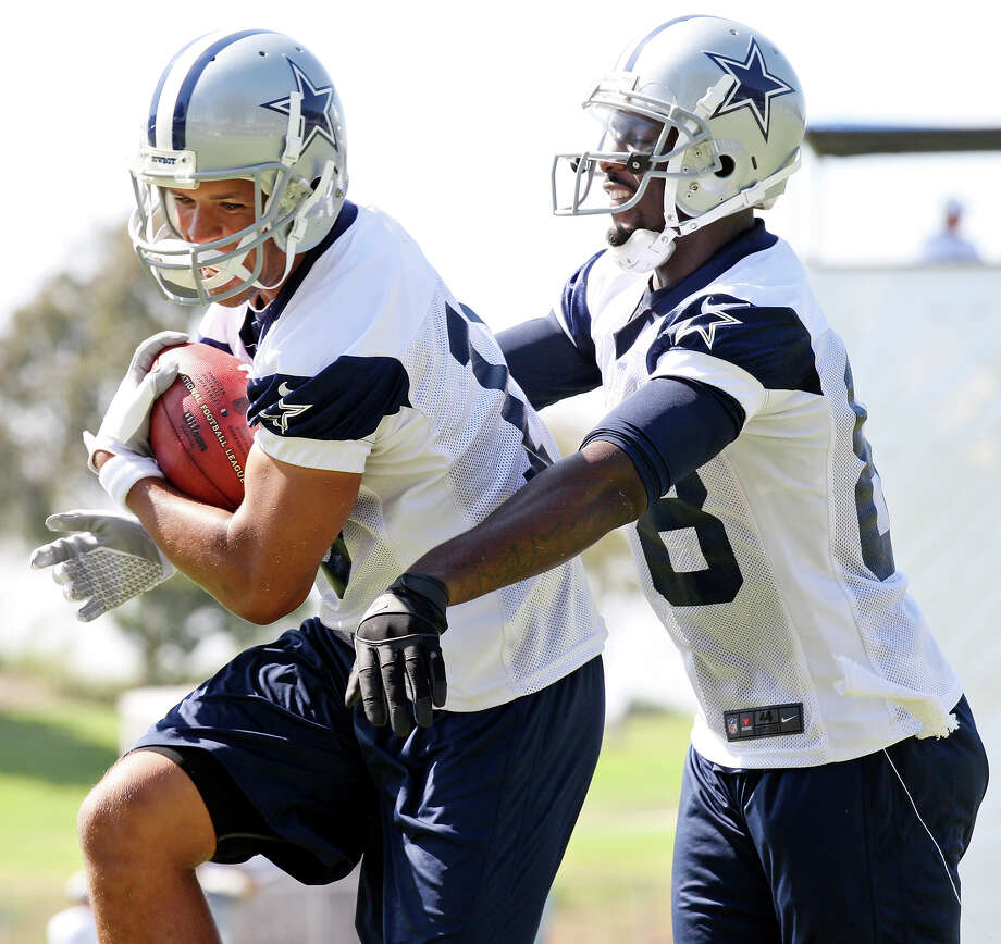 Dallas Cowboys wide receivers Miles Austin (left) and Dez Bryant take part in a drill during the first day of their 2012 training camp Monday July 30, 2012 in Oxnard, CA. Photo: Edward A. Ornelas, San Antonio Express-News / © 2012 San Antonio Express-News