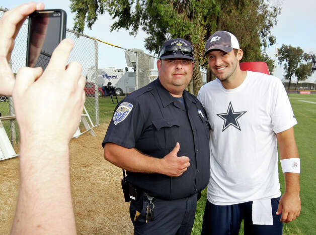 Dallas Cowboys quarterback Tony Romo (right) poses for a photo with Frank Villa after the first day of the Cowboys 2012 training camp Monday July 30, 2012 in Oxnard, CA. Photo: Edward A. Ornelas, San Antonio Express-News / © 2012 San Antonio Express-News