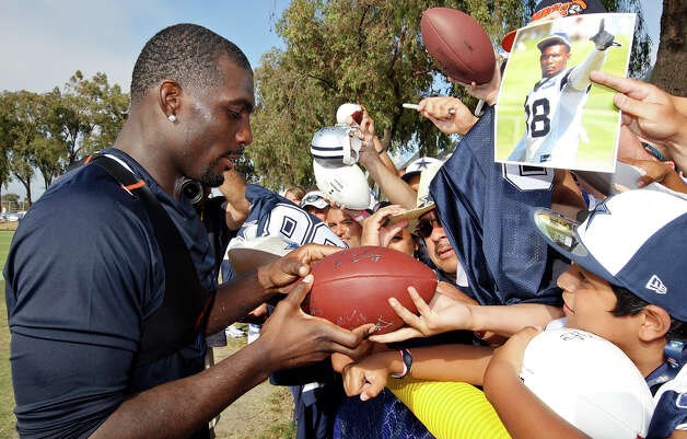 Dallas Cowboys wide receiver Dez Bryant signs autographs for fans after the first day of their 2012 training camp held Monday July 30, 2012 in Oxnard, CA. Photo: Edward A. Ornelas, San Antonio Express-News / © 2012 San Antonio Express-News