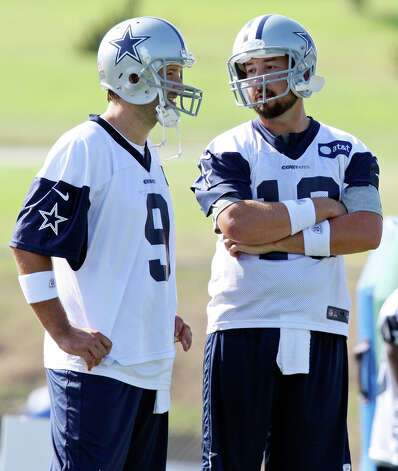 Dallas Cowboys quarterbacks Tony Romo (left) and Kyle Orton talk during the first day of their 2012 training camp held Monday July 30, 2012 in Oxnard, CA. Photo: Edward A. Ornelas, San Antonio Express-News / © 2012 San Antonio Express-News