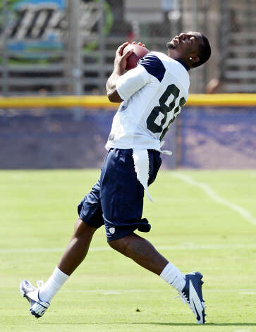 Dallas Cowboys wide receiver Dez Bryant catches a pass during the first day of their 2012 training camp Monday July 30, 2012 in Oxnard, CA. Photo: Edward A. Ornelas, San Antonio Express-News / © 2012 San Antonio Express-News
