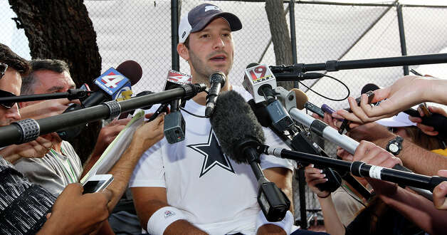 Dallas Cowboys quarterback Tony Romo answers questions from the media after the first day of their 2012 training camp held Monday July 30, 2012 in Oxnard, CA. Photo: Edward A. Ornelas, San Antonio Express-News / © 2012 San Antonio Express-News