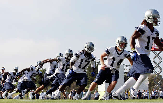 Members of the Dallas Cowboys football team run drills during the first day of their 2012 training camp held Monday July 30, 2012 in Oxnard, CA. Photo: Edward A. Ornelas, San Antonio Express-News / © 2012 San Antonio Express-News