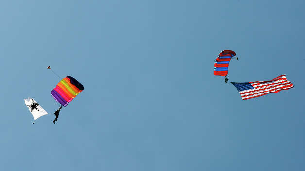 Skydivers perform over the Dallas Cowboys 2012 training camp held Monday July 30, 2012 in Oxnard, CA. Photo: Edward A. Ornelas, San Antonio Express-News / © 2012 San Antonio Express-News