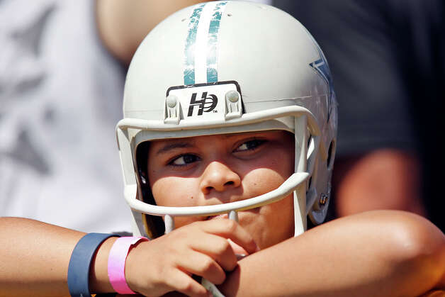 Dallas Cowboys fan Sabrina Ramos, 10, takes in the sights during the first day of their 2012 training camp held Monday July 30, 2012 in Oxnard, CA. Photo: Edward A. Ornelas, San Antonio Express-News / © 2012 San Antonio Express-News