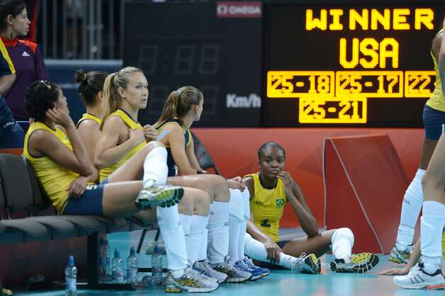 Brazil's players react after the women's preliminary Pool B volleyball match between the US and Brazil in the 2012 London Olympic Games in London on July 30, 2012. (KIRILL KUDRYAVTSEV / AFP/Getty Images)