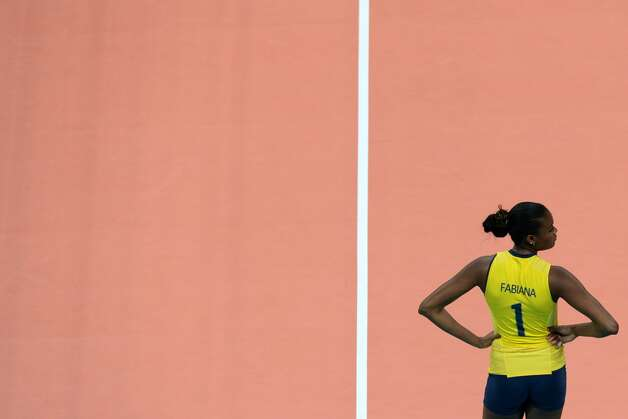Brazil's Fabiana Claudino reacts during the women's preliminary pool B volleyball match between the US and Brazil in the 2012 London Olympic Games in London on July 30, 2012. (KIRILL KUDRYAVTSEV / AFP/Getty Images)