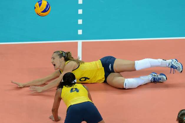 Brazil' Fernanda Ferreira attempts to set the ball during the women's preliminary pool B volleyball match between the US and Brazil in the 2012 London Olympic Games in London on July 30, 2012. (KIRILL KUDRYAVTSEV / AFP/Getty Images)