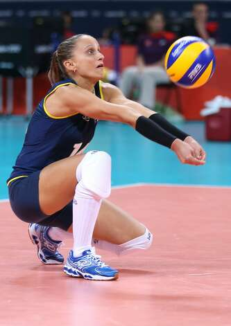 Fabiana Oliveira of Brazil returns serve in the Women's Volleyball Preliminary match between the United States and Brazil on Day 3 of the London 2012 Olympic Games at Earls Court on July 30, 2012 in London, England. (Elsa / Getty Images)