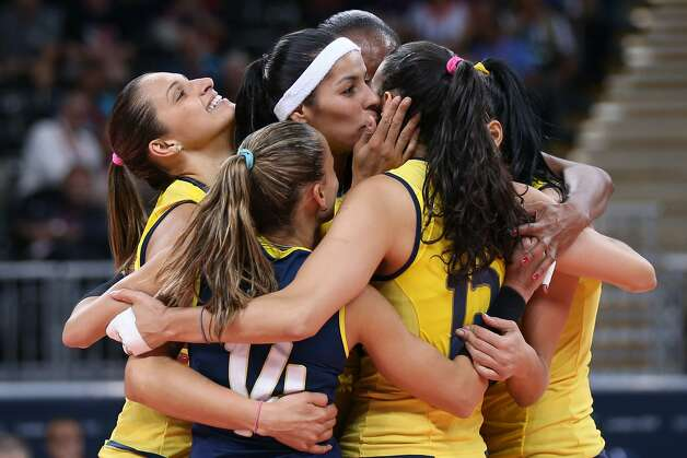 Brazil player celebrate winning a point in the Women's Volleyball Preliminary match between the United States and Brazil on Day 3 of the London 2012 Olympic Games at Earls Court on July 30, 2012 in London, England. (Elsa / Getty Images)