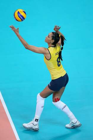 Jaqueline Carvalho of Brazil serves in the Women's Volleyball Preliminary match between the United States and Brazil on Day 3 of the London 2012 Olympic Games at Earls Court on July 30, 2012 in London, England. (Elsa / Getty Images)