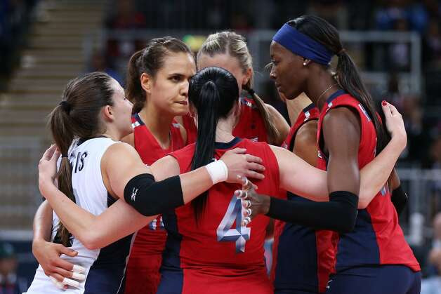 The United States team celebrates a point in the Women's Volleyball Preliminary match between the United States and Brazil on Day 3 of the London 2012 Olympic Games at Earls Court on July 30, 2012 in London, England. (Elsa / Getty Images)