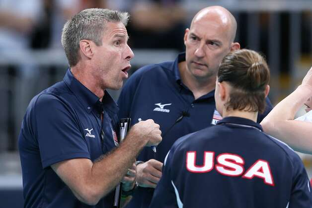 The United States head coach Hugh McCutcheon and assistant Karch Kiraly (L) discuss tactics in the Women's Volleyball Preliminary match between the United States and Brazil on Day 3 of the London 2012 Olympic Games at Earls Court on July 30, 2012 in London, England. (Elsa / Getty Images)