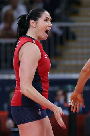 Lindsey Berg of United States celebrates winning a point in the Women's Volleyball Preliminary match between the United States and Brazil on Day 3 of the London 2012 Olympic Games at Earls Court on July 30, 2012 in London, England. (Elsa / Getty Images)