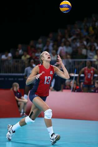 Christa Harmotto of United States serves in the Women's Volleyball Preliminary match between the United States and Brazil on Day 3 of the London 2012 Olympic Games at Earls Court on July 30, 2012 in London, England. (Elsa / Getty Images)