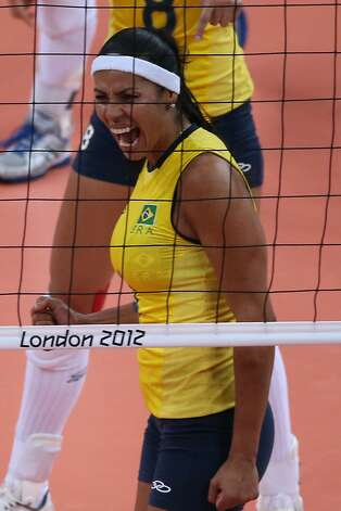 Paula Pequeno of Brazil celebrates a point in the Women's Volleyball Preliminary match between the United States and Brazil on Day 3 of the London 2012 Olympic Games at Earls Court on July 30, 2012 in London, England. (Elsa / Getty Images)