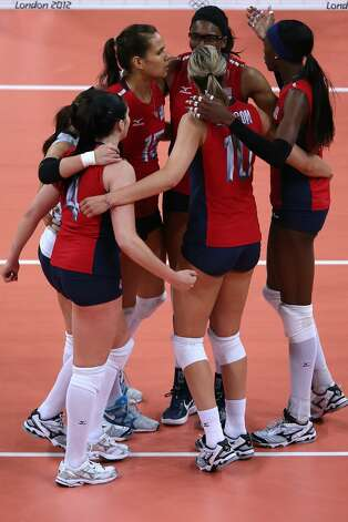 The United States players celebrate a point in the Women's Volleyball Preliminary match between the United States and Brazil on Day 3 of the London 2012 Olympic Games at Earls Court on July 30, 2012 in London, England. (Elsa / Getty Images)