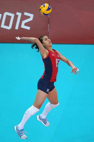 Logan Tom of United States serves in the Women's Volleyball Preliminary match between the United States and Brazil on Day 3 of the London 2012 Olympic Games at Earls Court on July 30, 2012 in London, England. (Elsa / Getty Images)