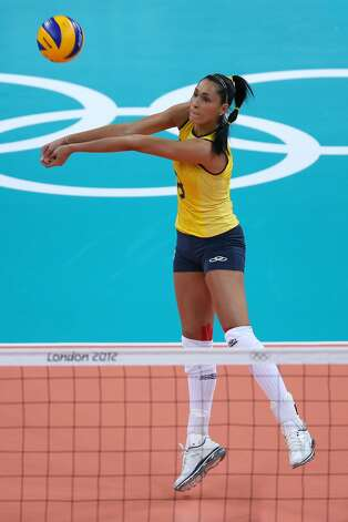 Jaqueline Carvalho of Brazil returns the ball during Women's Volleyball on Day 3 of the London 2012 Olympic Games at Earls Court on July 30, 2012 in London, England. (Elsa / Getty Images)