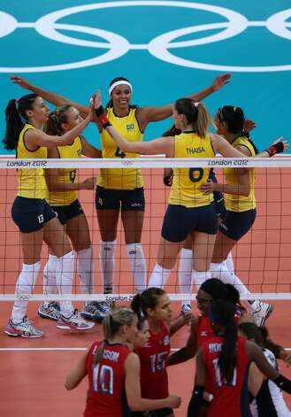 Brazil players celebrate a goal during Women's Volleyball on Day 3 of the London 2012 Olympic Games at Earls Court on July 30, 2012 in London, England. (Elsa / Getty Images)