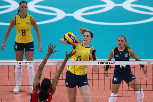 Nicole Davis of United States spikes the ball in the Women's Volleyball Preliminary match between the United States and Brazil on Day 3 of the London 2012 Olympic Games at Earls Court on July 30, 2012 in London, England. (Elsa / Getty Images)
