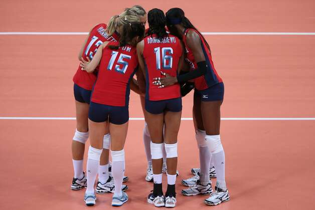 The United States form a huddle prior to the Women's Volleyball Preliminary match between the United States and Brazil on Day 3 of the London 2012 Olympic Games at Earls Court on July 30, 2012 in London, England. (Elsa / Getty Images)