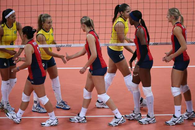 Competitors greet each other at the net prior to the Women's Volleyball Preliminary match between the United States and Brazil on Day 3 of the London 2012 Olympic Games at Earls Court on July 30, 2012 in London, England. (Elsa / Getty Images)