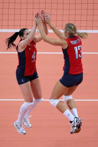 Lindsey Berg of United States greets team mate Christa Harmotto prior to the Women's Volleyball Preliminary match between the United States and Brazil on Day 3 of the London 2012 Olympic Games at Earls Court on July 30, 2012 in London, England. (Elsa / Getty Images)