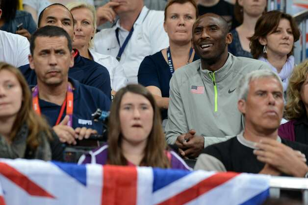 US basketball player Kobe Bryant (R) attends the women's preliminary pool B volleyball match between the US and Brazil in the 2012 London Olympic Games in London on July 30, 2012. (KIRILL KUDRYAVTSEV / AFP/Getty Images)