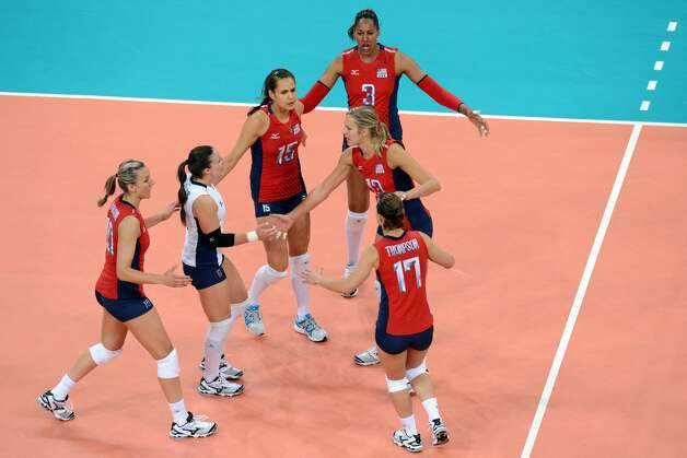 US players celebrate scoring a point against Brazil during their London 2012 Olympic Games women's preliminary volleyball match in London on July 30, 2012. (KIRILL KUDRYAVTSEV / AFP/Getty Images)