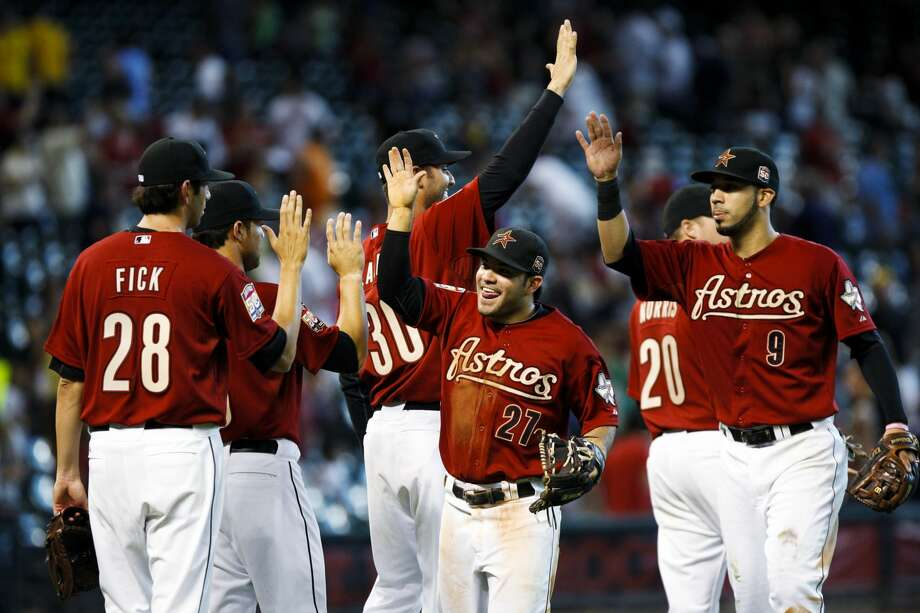 July 29, 2012Chuckie Fick (28), Armando Galarraga (30), Fernando Martinez (21), Bud Norris (20) and Marwin Gonzalez (9) celebrate snapping the longest losing streak in franchise history with a 9-5 win over the Pirates. (Eric Kayne / Associated Press)