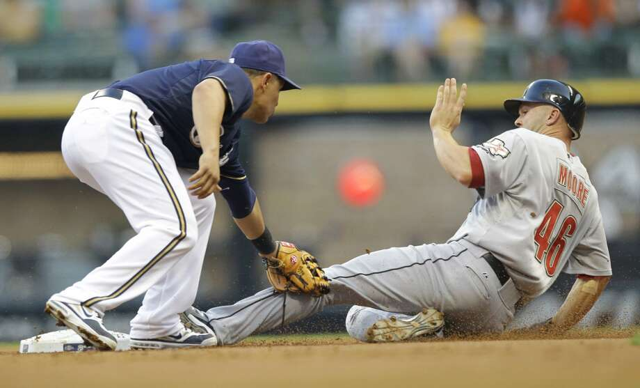 July 30, 2012 Scott Moore is tagged out trying to steal second base during the second inning of the Astros 8-7 loss to the Brewers. It was their seventh one-run loss of the month and dropped their record in July to 3-23. (Jeffrey Phelps / Associated Press)