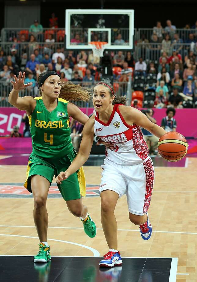 Becky Hammon #9 of Russia drives the ball past Adriana Pinto #4 of Brazil during the Women's Basketball Preliminary Round match on Day 3 at Basketball Arena on July 30, 2012 in London, England. (Christian Petersen / Getty Images)