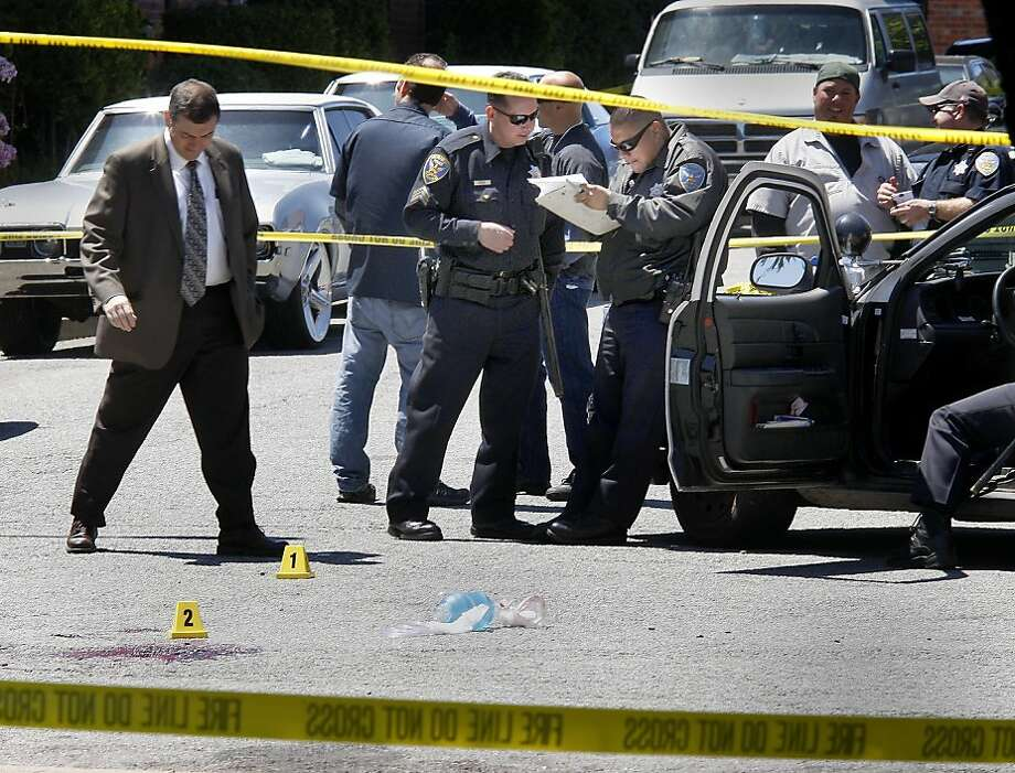 Police collected evidence near a pool of blood where one of the victims was shot. San Francisco police are investigating a shooting of two men in the Sunnydale area near the corner of Burr and Argonaut Avenues. Photo: Brant Ward, The Chronicle
