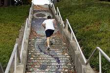 People workout on the staircase on Moraga and 16th Ave in San Francisco, Ca on March 20, 2012.