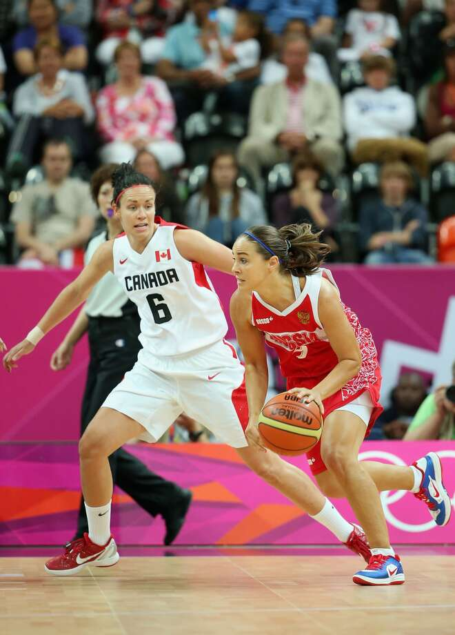Becky Hammon #9 of Russia drives against Shona Thorburn #6 of Canada during Women's Basketball on Day 1 of the London 2012 Olympic Games at the Basketball Arena on July 28, 2012 in London, England. (Christian Petersen / Getty Images)