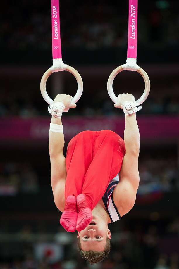 Jonathan Horton of Houston performs on still rings during the men's gymnastics team final at the 2012 London Olympics on Monday, July 30, 2012. The USA finished in 5th place. (Smiley N. Pool / Houston Chronicle)
