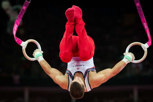 Jake Dalton of the USA performs on still rings during the men's gymnastics team final at the 2012 London Olympics on Monday, July 30, 2012. The USA finished in 5th place. (Smiley N. Pool / Houston Chronicle)